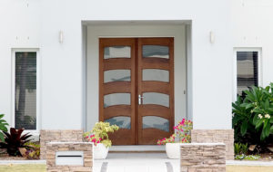 Modern exterior door for home with mix of wood and glass panels