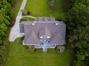 Aerial view of home with roof